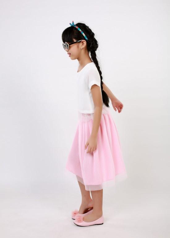 Chân váy dập li hồng bé gái