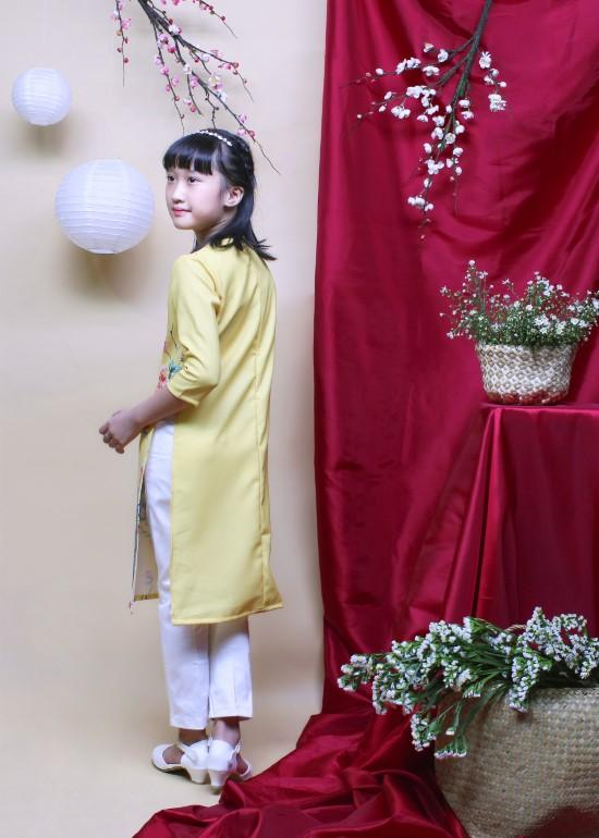 Áo dài hưng thịnh vàng bé gái