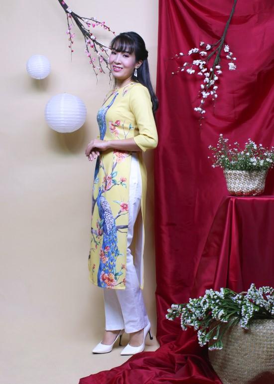Áo dài hưng thịnh vàng nữ