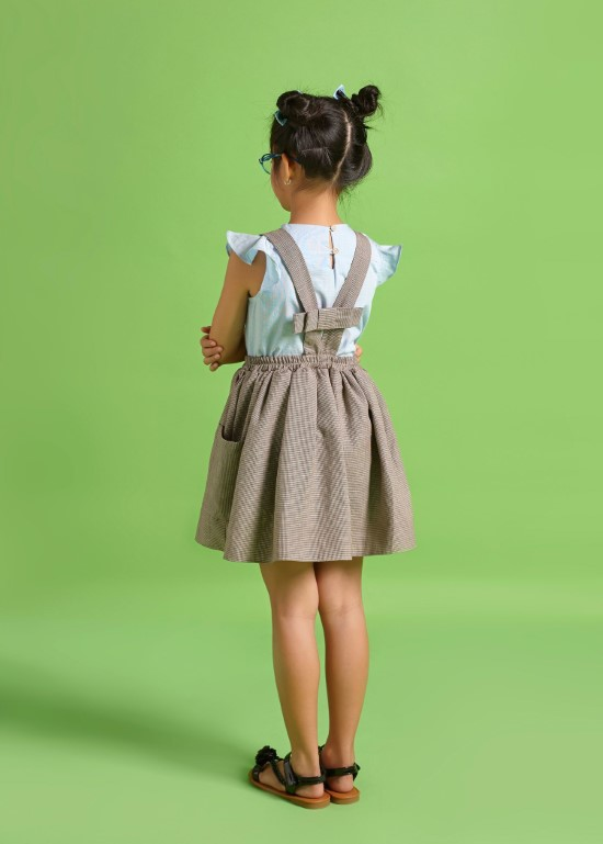 Chân váy hai dây nơ lưng caro nhí nâu bé gái